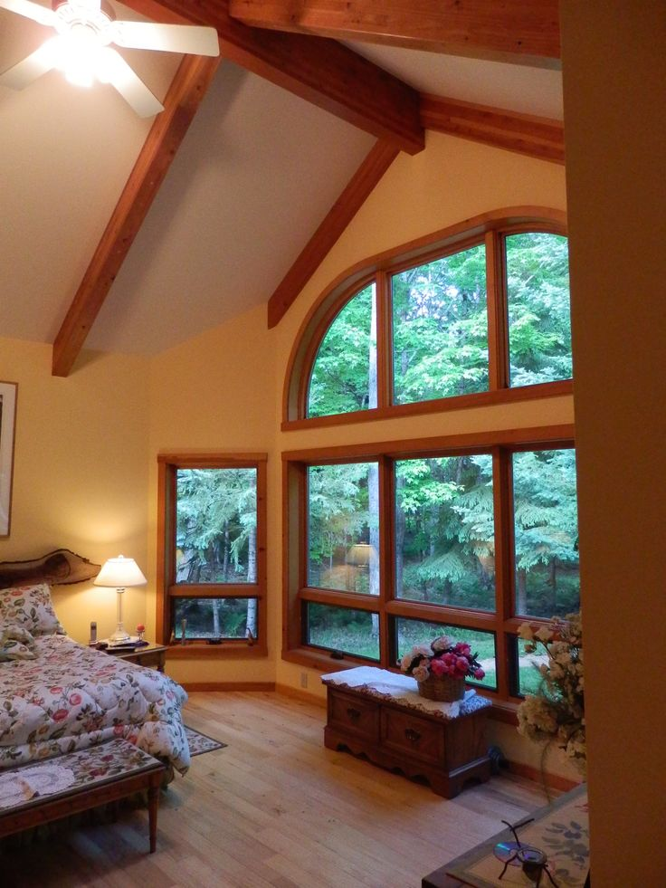 Learn about vaulted ceilings for vilas county custom home Master bedroom with sloped ceiling